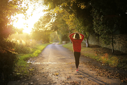 Woman jogging along empty path on her own
