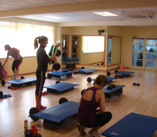 Participants getting ready to start a fitness class in the studio